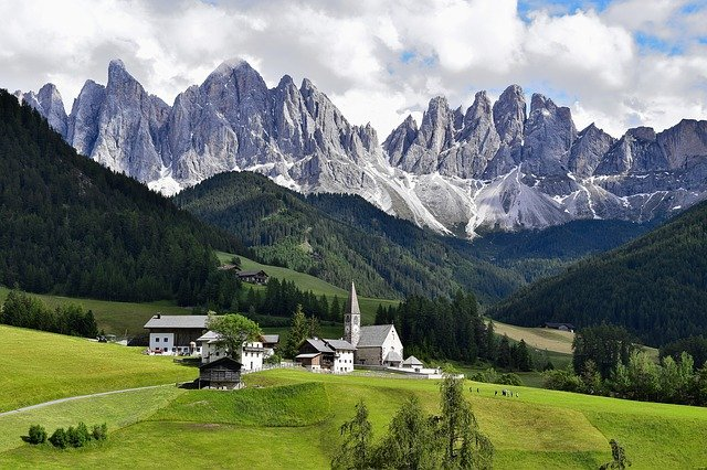 A large mountain in the background with Dolomites in the background